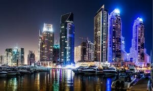 DUBAI UAE - NOVEMBER 13: Dubai downtown night scene with city lights luxury new high tech town in middle East. Dubai Marina cityscape on November 13 2012 in Dubai UAE. ** Note: Visible grain at 100%, best at smaller sizes