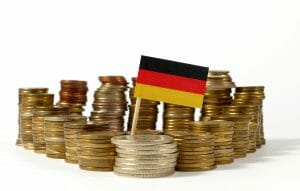 Germany flag waving with stack of money coins