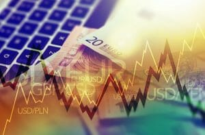 Trading Markets. Forex Currency Trading Concept with Computer Cash Euro Money and Some Line Graph Statistics.